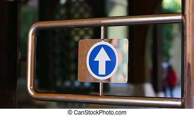 Entering through turnstile