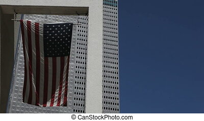 American Flag in Front of a Skyscraper in downtown Dallas
