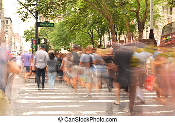 People crossing busy street