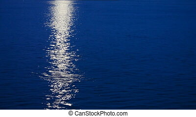 Lunar path - Beautiful lunar path reflection on a dark blue...