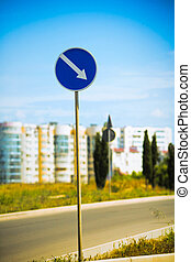 Curved Road Traffic Sign over blue
