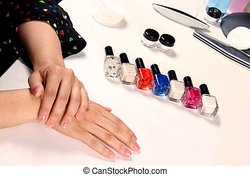 female hands and manicure objects