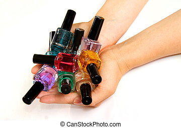 bunch of nail varnish vials in female hands
