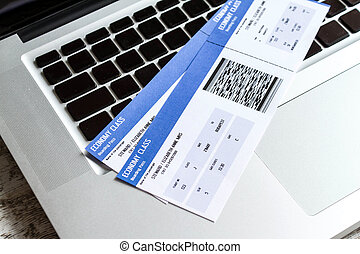 Check in on line - Airline tickets over the keyboard of a...