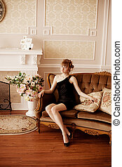 Stylish woman in the luxurious interior
