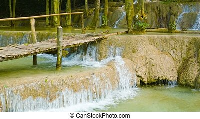Kouang Si Waterfall, Laos, Luang Prabang. Look with a wooden...