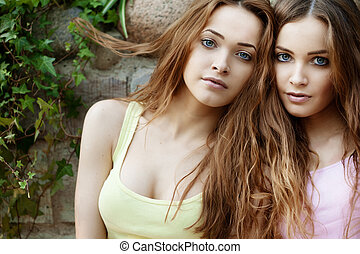 Beautiful young twins outdoors - Beautiful young happy twins...