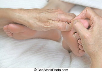Close-up reflexology treatment