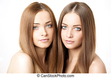 Beauty portrait of two beautiful young women - Close-up...