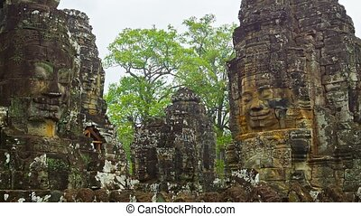 Towers of the ancient temple with stone faces. Cambodia, Bayon