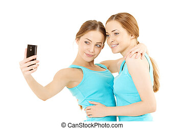 wo women make the photo to mobile phone - Two smiling women...