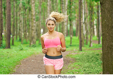 Woman sports, running in the park - Young woman sports,...