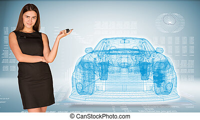 Businesswoman with key and wire frame car High-tech graphs...