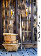 thai bamboo basket hand craft with wood wall rural home...