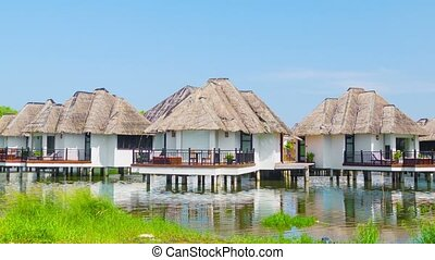 Bungalows on the waters edge Tranquil place to stay - Video...