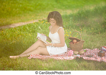 Beautiful woman on picnic on nature Beautiful Young girl...