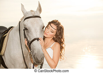 Young woman on a horse Horseback rider, woman riding horse...