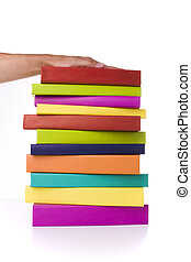 holding a stack of books - big colorful stack of books...
