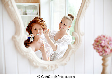 Hair stylist makes the bride before the wedding - Hair...