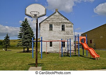 School playground in small town - Basketball and playground...