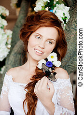 Beautiful bride in a luxurious interior with flowers -...