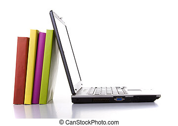 Modern school - a laptop next to a stack of colorful books