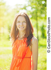 Beauty young woman on nature in the park. Wind in the hair -...