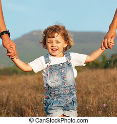 Happy mother and father with daugther