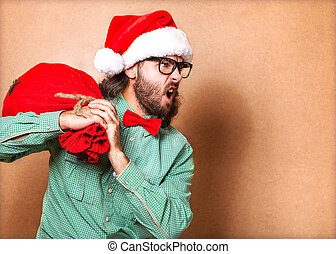 hipster in Santa Claus clothes with the socks of the...