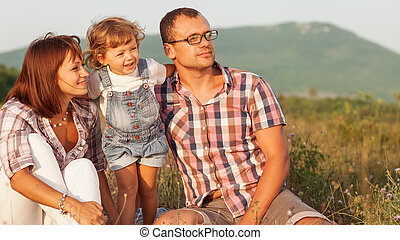 Happy family having fun outdoors and smiling