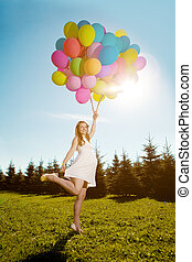 Young healthy beautiful pregnant woman with balloons...