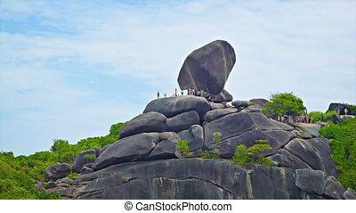 Rocks with numerous tourists. Thailand, Similan - Video...