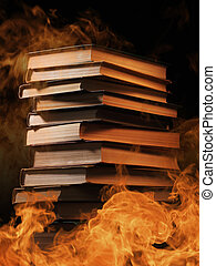 Stack of books in a burning fire - Conceptual image of a...