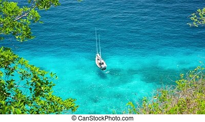 Yacht anchored near the shore. Top view