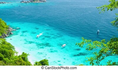 Yachts in shallow water near the tropical island. View from the mountain. Thailand, Similan