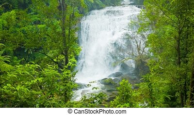 Large waterfall in Thailand near Chiang Mai View through the...