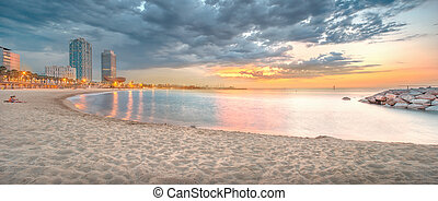 Barceloneta Beach in Barcelona at sunrise - Barceloneta...
