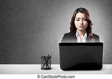 serious businesswoman working hard - Portrait of serious...
