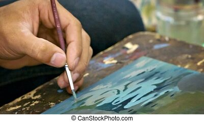 Artist draws a little picture close up