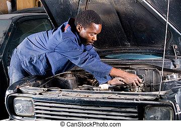 mechanic - a mechanic fixing a car