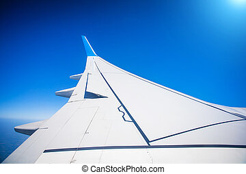 View of jet plane wing with blue sky - fantastic View of jet...