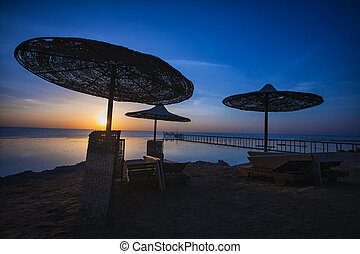 Sunset on the beach with parasol