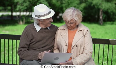 Technological Wonder - Senior couple enjoying technological...