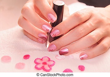 womans hands-manicure - womans hand holding nail polish...