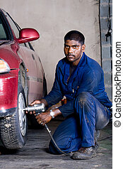 auto mechanic - an auto mechanic working on a car