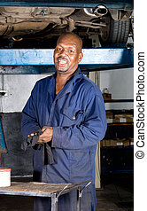 african mechanic - a happy african mechanic in overalls...
