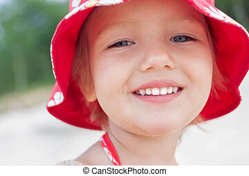 cheerful child girl smiling face close up outdoor