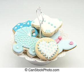 Butter cookies with icing decorated with childrens motifs
