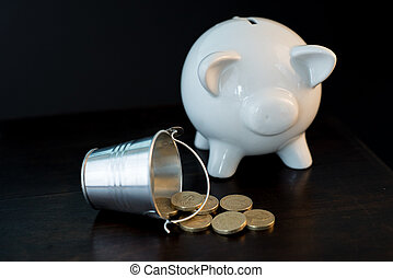 piggy bank and coins - white piggy bank isolated on black...