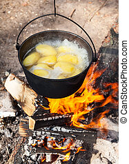 Campfire cooking - Cooking potatoes on a campfire
